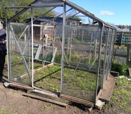 old greenhouse bought from neighbouring plot and moved, pane by pane to our site